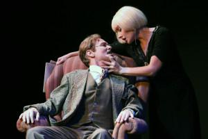 Richard Hannay (John Stedelman) has the attention of seductive espionage agent, Annabella Smith (Katie Worley) in Oregon Cabaret Theatre's The 39 Steps