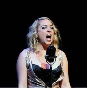 "Kit Kat Club singer Sally Bowles (Jillian Van Niel) belts out a song in Oregon Cabaret Theater's production of ""Cabaret""."