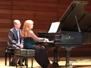 Tutunov piano student, Jodi French, performing, with Mr. Tutunov turning pages, during Tutunov Piano Series concert in Ashland, OR on Oct. 17, 2014
