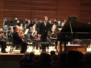 Piano soloist Stanislav Khristenko acknowledges applause after performing during Rogue Valley Symphony's Masterworks Series I Concert, Sept. 25, 2015 at S.O.U. Music Recital Hall, Ashland, OR.