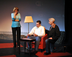 Eugenie (Barbara Henson) watches as Raymond Shaw's (Aaron Garber) brainwashing is triggered by Ben Marco (Mark Schneider) in Camelot Theatre's The Manchurian Candidate