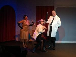 Professor Fenton (Jacob Uhlman) being tortured by Lenya Von Brunno (V. Simone Stewart) and Otto Von Brunno (John Richardson) in Randall Theater's Bullshot Crummond