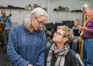 Director Presila Quinby discusses details of the Camelot Theatre Spotlight on Carole King production with script writer and featured performer Gayle Wilson during rehearsal.