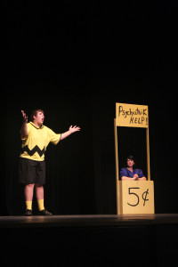 """Charlie Brown (Jacob Hearne) getting advice from Lucy (Tiffany Aslakson) in Crater Drama's """"You're a Good Man, Charlie Brown"""". Photo by Bailey Hilkey."""