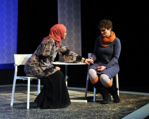 Adoptive-mother-to-be Sahrrah Shouman (Stephanie Jones) and Sister-in-law Tamara Greenwood (Rose Passione) discuss their differences in Camelot Theatre's production of Solomon's Blade