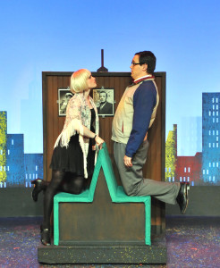 """Charity Valentine (Sarah Gore) and her love interest of the moment, Oscar (Alex Broyles) discuss their future at a diner, in Camelot Theatre's """"Sweet Charity""""."""