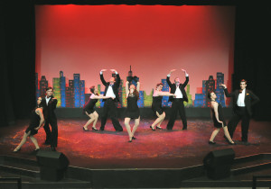 """Shannon Carter (center) and ensemble bring the house down with show stopping dance number, """"Rich Man's Frug"""" in Camelot Theatre's """"Sweet Charity""""."""