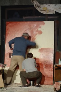 """Artist Mark Rothko (Peter Alzado) and assistant Ken (Reece Bredl) apply primer to canvas in Ashland Contemporary Theatre's """"Red""""."""