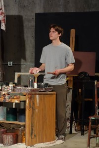 """Reece Bredl as artist's assistant Ken in Ashland Community Theatre's """"Red""""."""