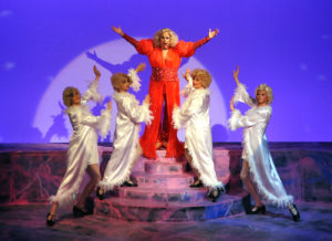 "David King-Gabriel performing as female impersonator ""Zaza"" with 4 Cagelle female impersonators at drag club in Camelot Theatre's La Cage Aux Folles."