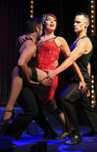 Layli Kayhani as Velma Kelly (center), with Edgar Lopez (left) and Jake Delaney (right) in Oregon Cabaret Theatre's Chicago
