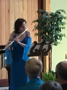 "Flutist Katheryn McElrath performing Katherine Hoover's ""Kokopeli"" during ""An Enchanted Evening"" concert, on July 17, 2016 at Grizzly Peak Winery, Ashland, OR"