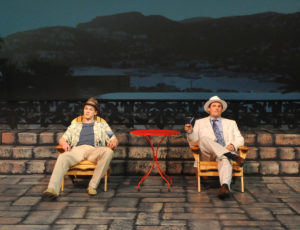 Con artists Freddy Benson (Eoghan McDowell) & Lawrence Jameson (Erik Connolly) in Camelot Theatre's Dirty Rotten Scoundrels. The two actors have effective chemistry in their scenes together, rivaling & exceeding that of the original film actors.