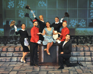 Charismatic and exuberant Camelot newcomer Sabrina Hebert (center) commands the stage and holds the attention in Camelot Theatre's Dirty Rotten Scoundrels. Here surrounded by (left to right) Shannon Carter, Dylan Spooner, Jasmin Evans, Carrie Ann Eve, Joey Larimer & Jake Hastings.